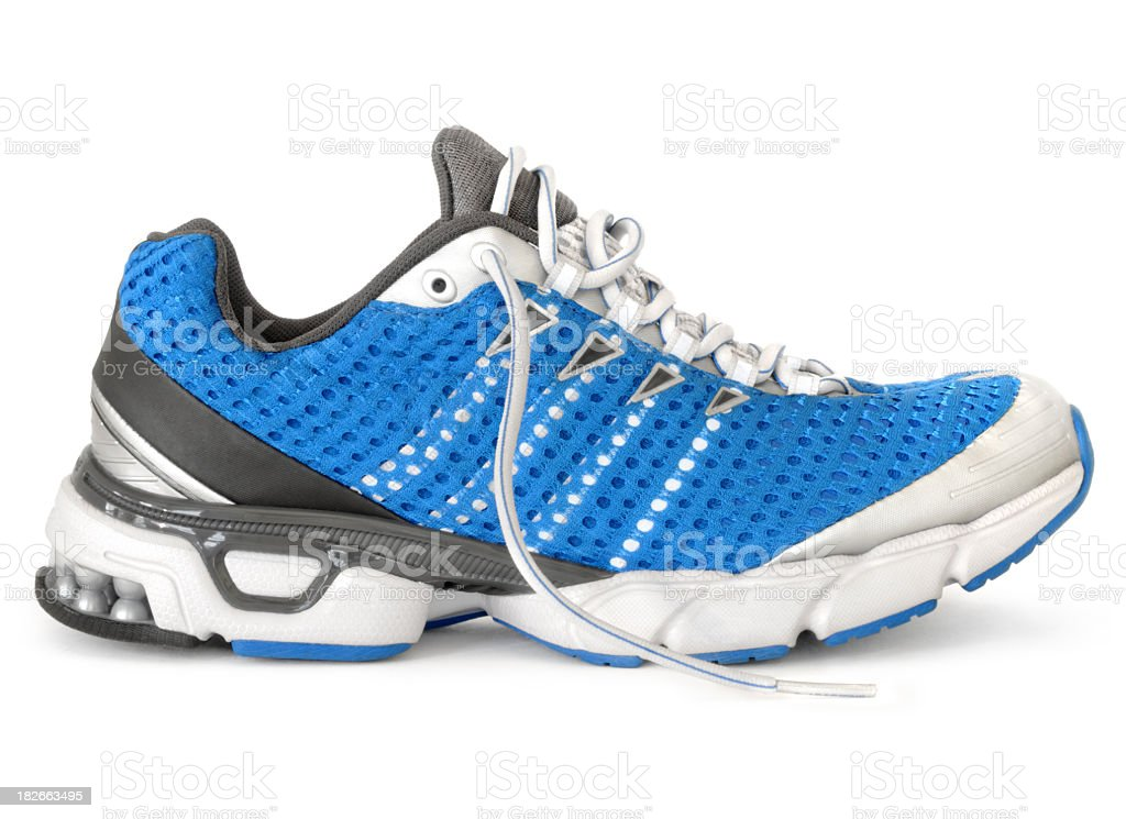 Men's blue, white, black, and gray running sneaker stock photo