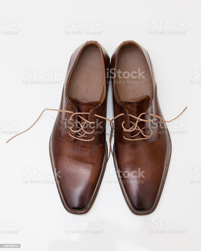 Mens brown leather shoes isolated stock photo