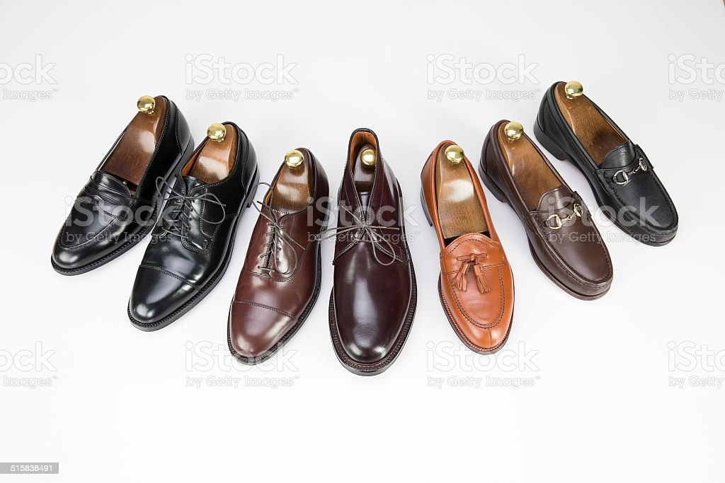 Men's business and dress shoes on white stock photo