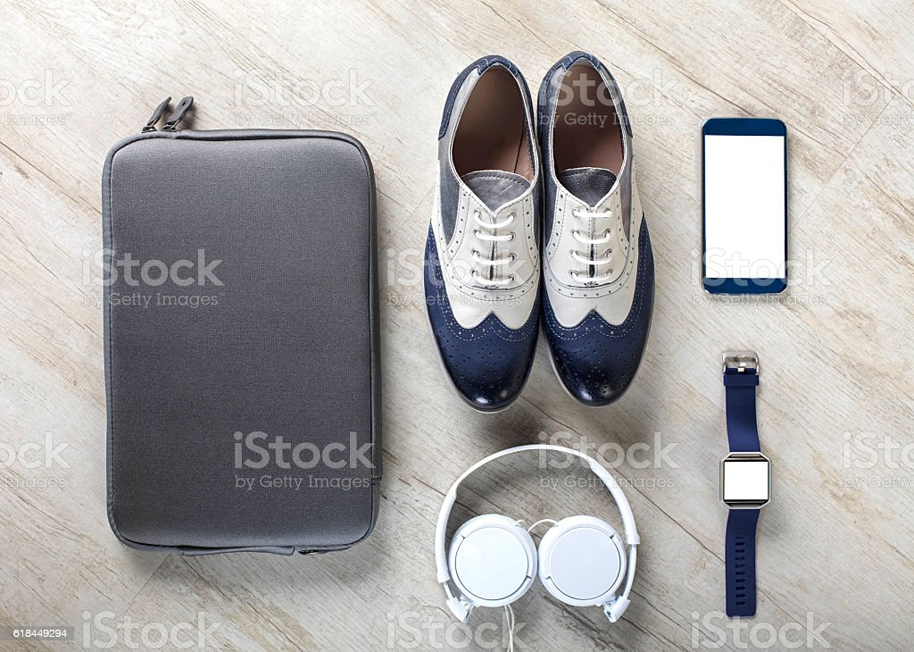 Men's casual business accessories organized on table stock photo