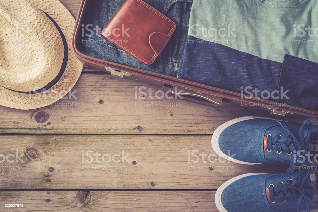 Men's casual clothing on wooden table stock photo