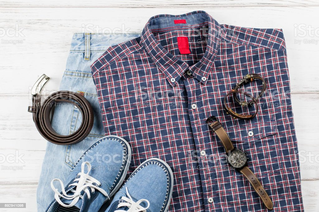 Men's casual outfit. Men's fashion clothing and accessories on white wooden background, flat lay stock photo