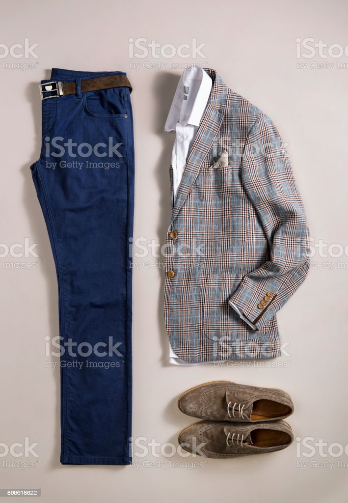 Men's clothes isolated on beige background stock photo
