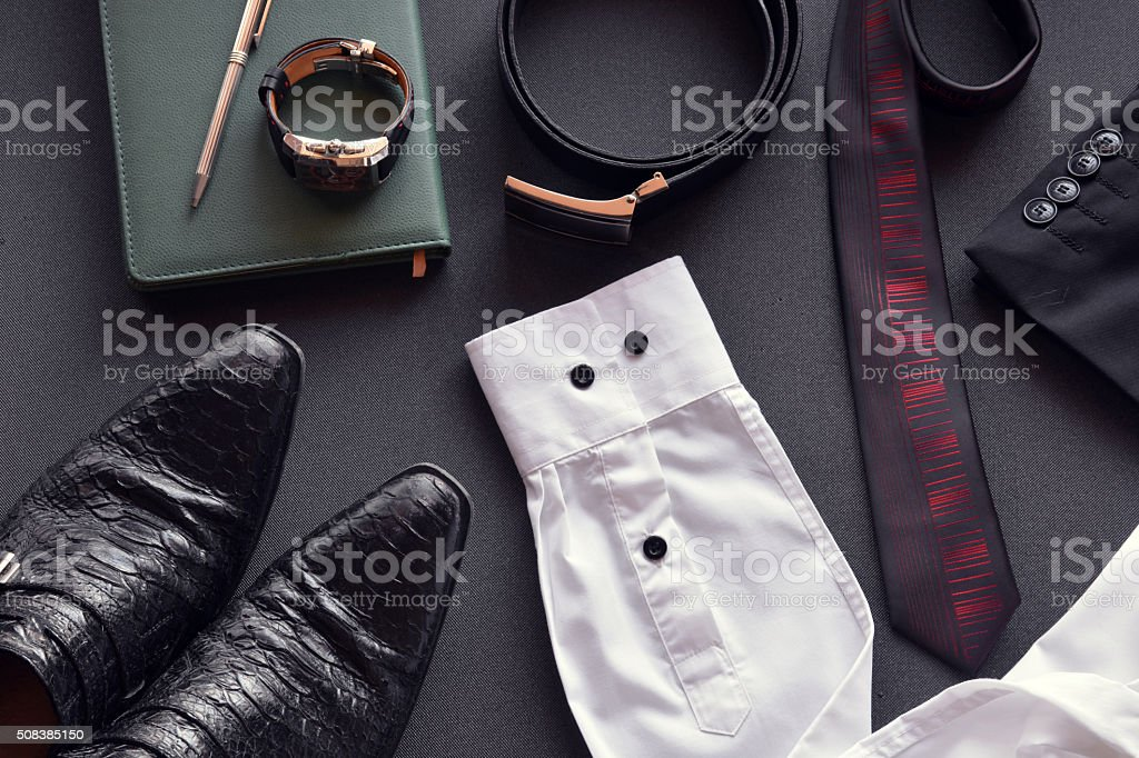 men's clothing along with several accessories stock photo