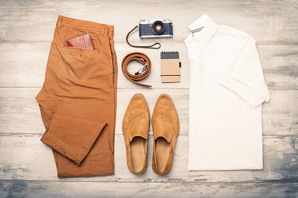 Men's clothing and objects on the floor stock photo