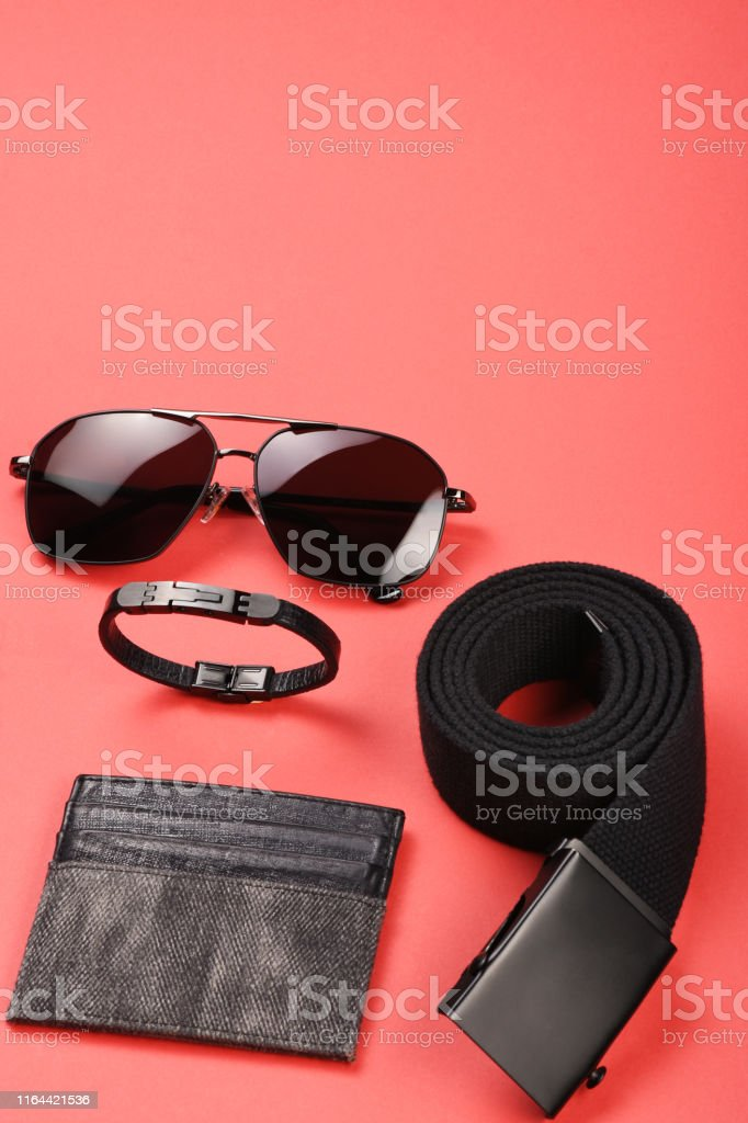 Men\'s clothing and personal accessories on red background