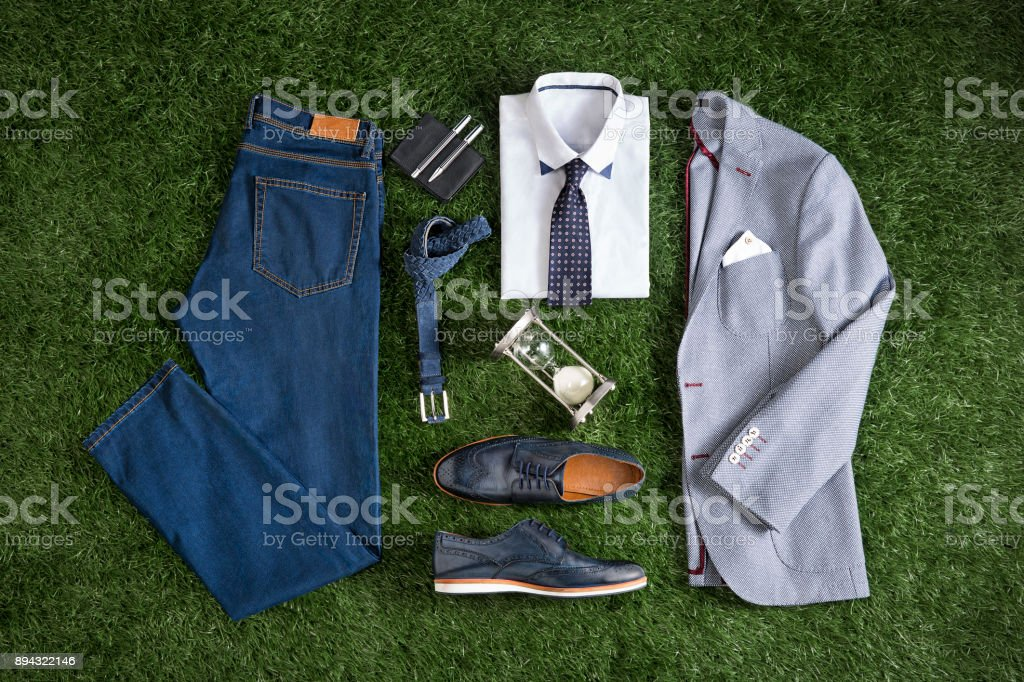 Men's clothing isolated on grass background stock photo