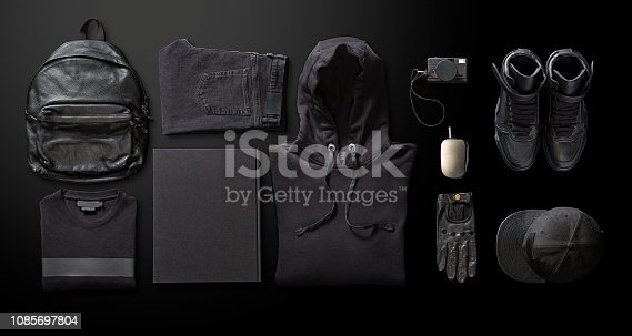 Men's clothing with personal accesorries on black background