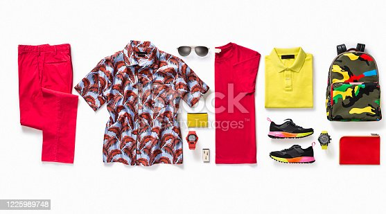 Men's clothing with personal accessories on white background