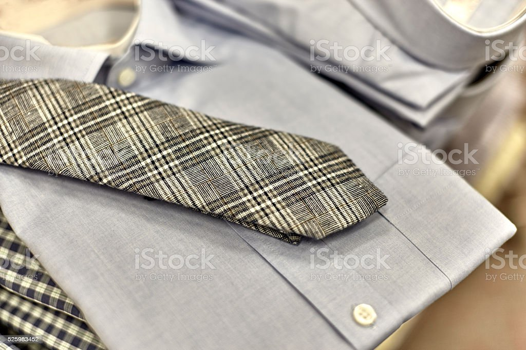 Mens Dress Shirts Stacked on Shelf stock photo