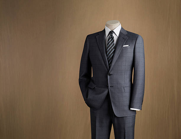 Mens Fashion Mannequin displaying mens suit in formal wear stock photo