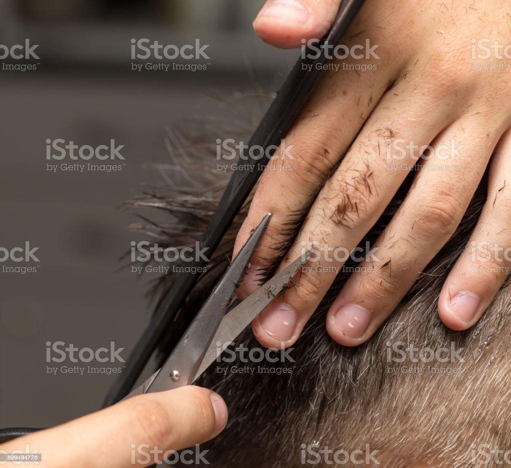 men's hair cutting scissors in a beauty salon stock photo