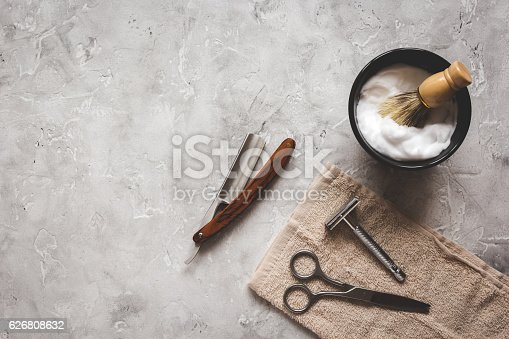 istock Mens hairdressing desktop with tools for shaving top view 626808632