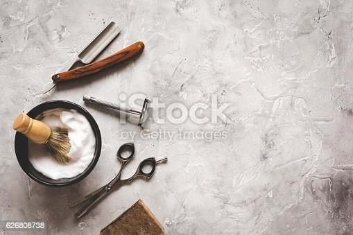 istock Mens hairdressing desktop with tools for shaving top view 626808738