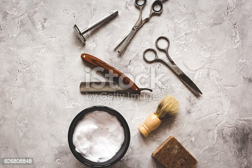 626808632istockphoto Mens hairdressing desktop with tools for shaving top view 626808848