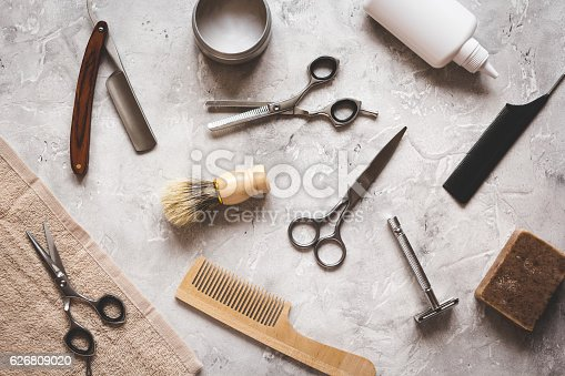 istock Mens hairdressing desktop with tools for shaving top view 626809020