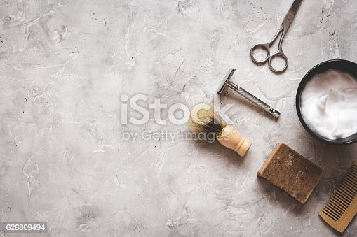 626808632istockphoto Mens hairdressing desktop with tools for shaving top view 626809494