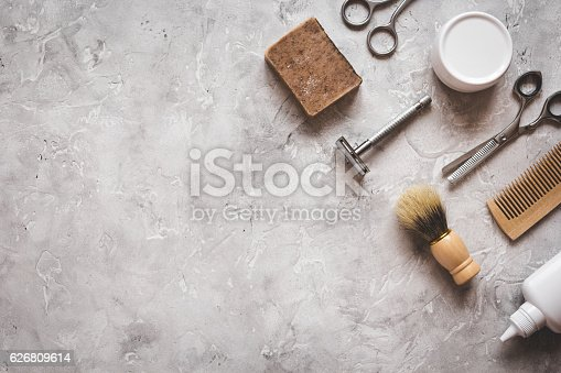 istock Mens hairdressing desktop with tools for shaving top view 626809614