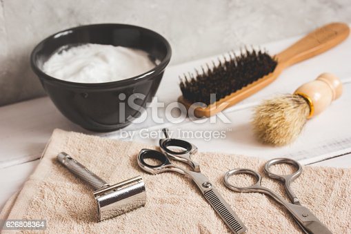 626808632istockphoto Mens hairdressing wooden desktop with tools for shaving 626808364
