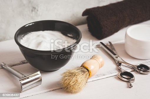 626808632istockphoto Mens hairdressing wooden desktop with tools for shaving 626808432