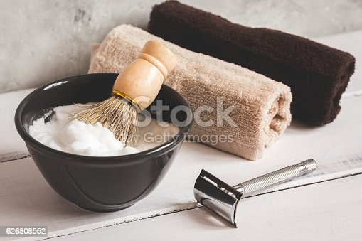 626808632istockphoto Mens hairdressing wooden desktop with tools for shaving 626808552