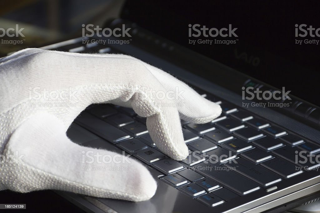 Men's hand white-gloved prints on the computer royalty-free stock photo