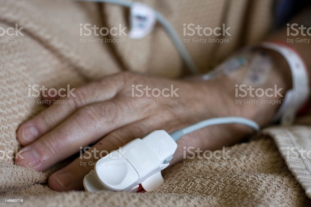 Men's hand with pulse ox monitor. royalty-free stock photo