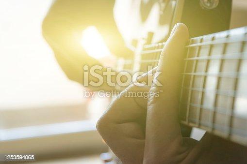 Men's hands, a guy plays the guitar