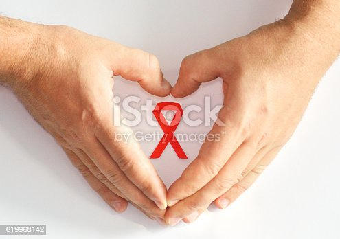 istock Men's Hands, Heart Shape and Red Ribbon 619968142