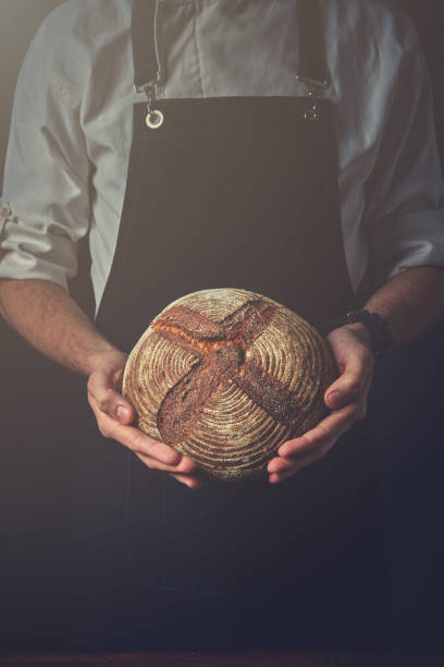Men's hands hold bread stock photo