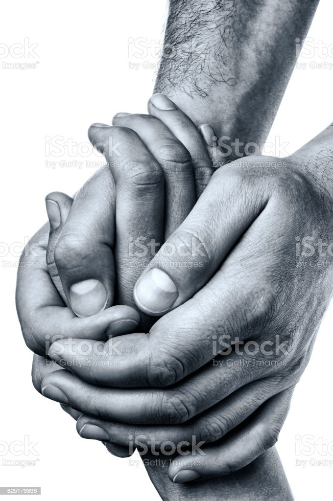 Men's hands hold the female palm. stock photo