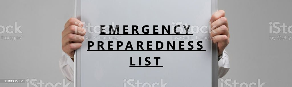Emergency preparedness list in the hands in a white shirt....