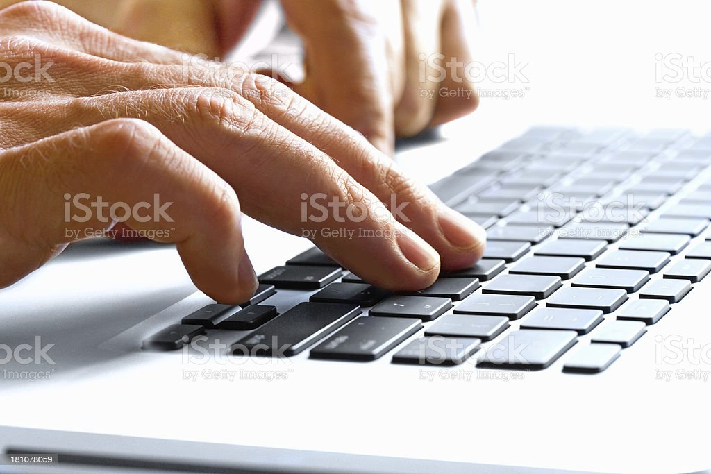 Men's Hands typing on the keyboard laptop royalty-free stock photo