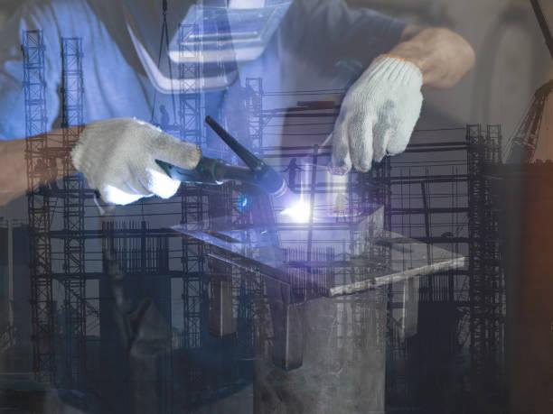 men's hands with argon welding machine.  repair pipe stainless argon welding industrial on construction background - double exposure стоковые фото и изображения