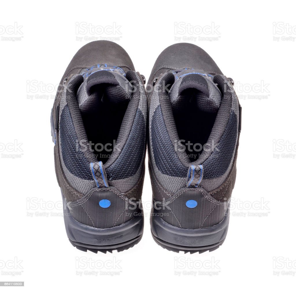 Men's hiking shoes on an isolated stock photo