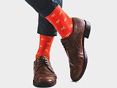istock Men's legs, trendy shoes and bright socks 1133646606