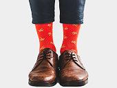 istock Men's legs, trendy shoes and bright socks 1133646740