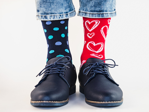 Men's legs, trendy shoes and bright socks. Close-up. Style, beauty and elegance concept