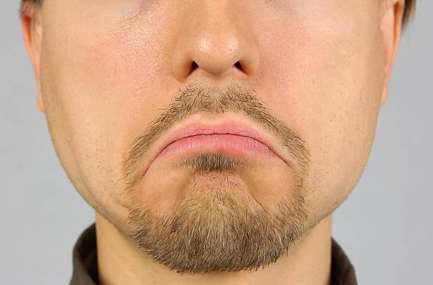 men's lips corners down, sad, closeup - deplorable stock pictures, royalty-free photos & images