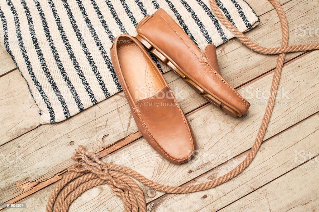 Men's Loafer Shoe on old wood royalty-free stock photo