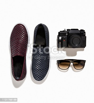 Men's loafers with camera and sunglasses isolated on white background (with clipping path)