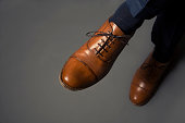 Pair of men's luxury shoes isolated on grey background.