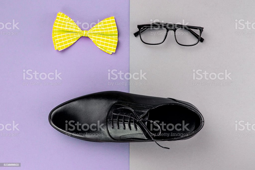 Men's objects on color table stock photo