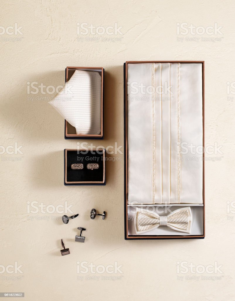 Men's personal accessories isolated on belge background