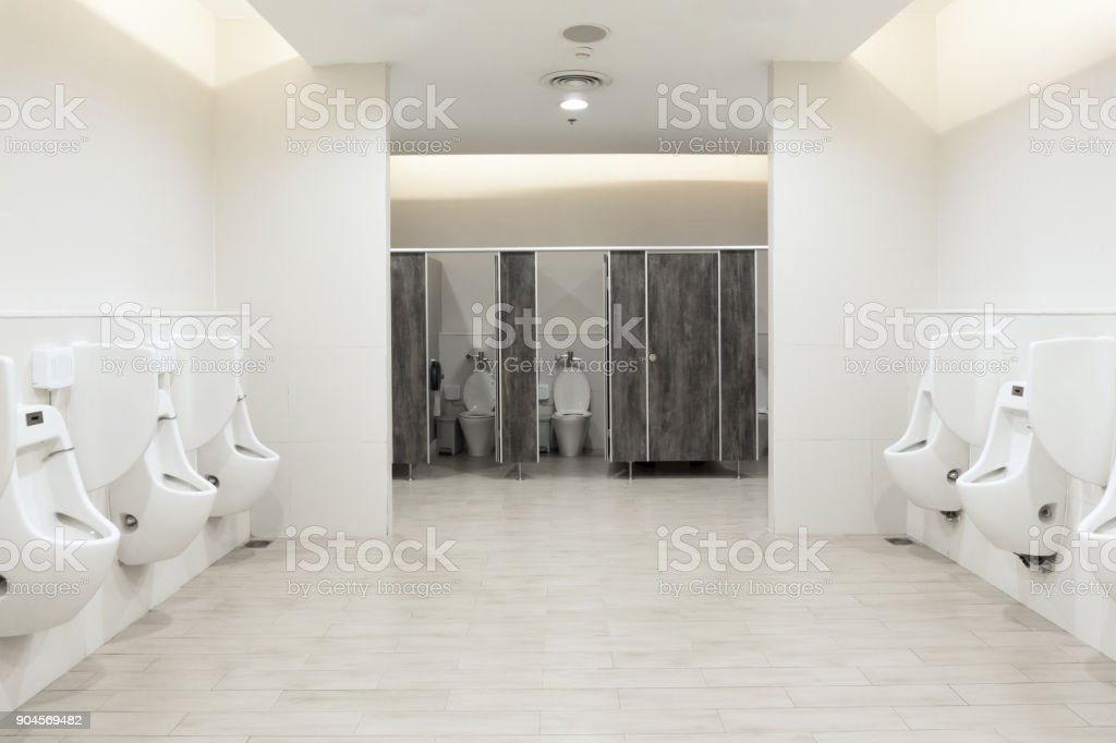 Men's room urinals discharge ,Toilet bowl in a modern bathroom stock photo