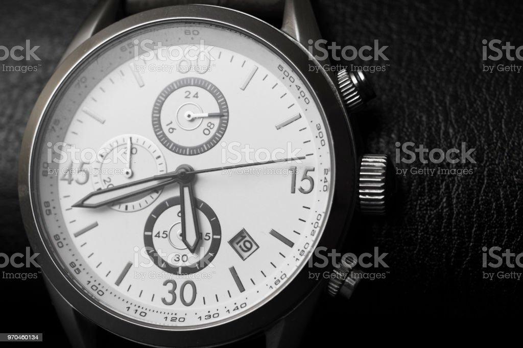 Mens round swiss mechanical wristwatch black and white stock photo