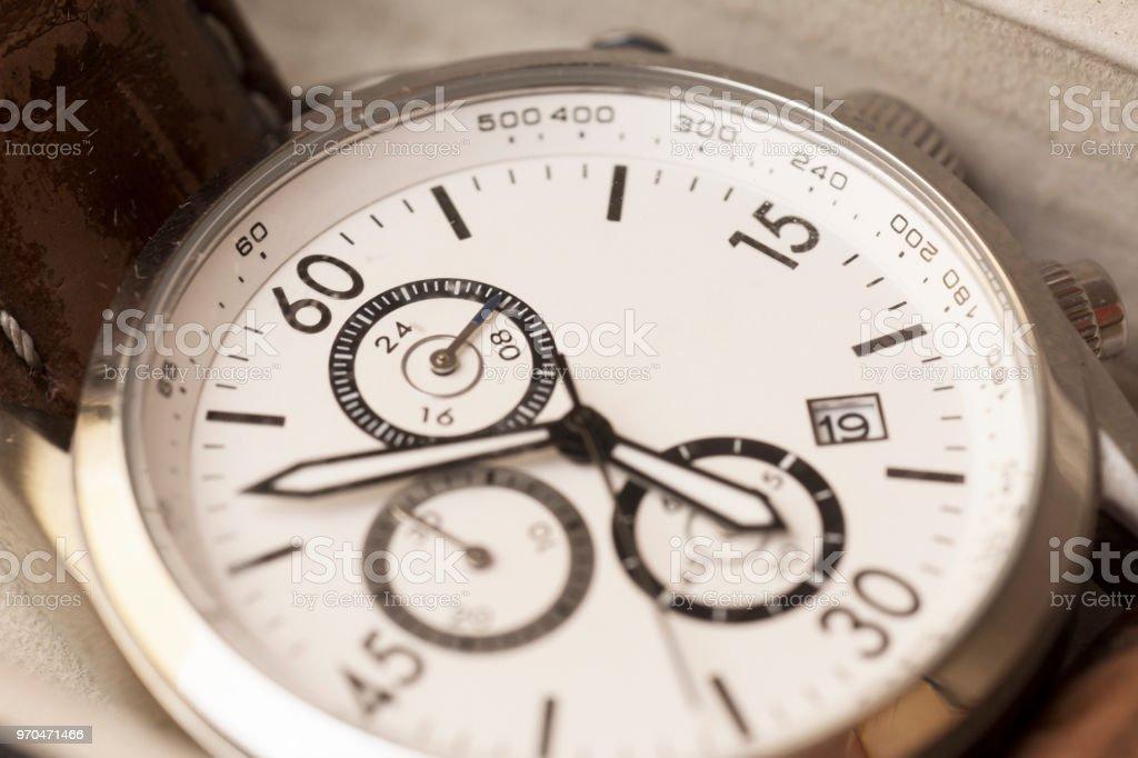 Mens round swiss mechanical wristwatch closeup stock photo