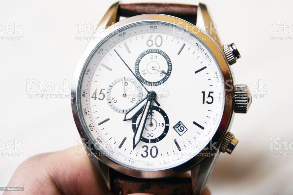 Mens round swiss mechanical wristwatch stock photo