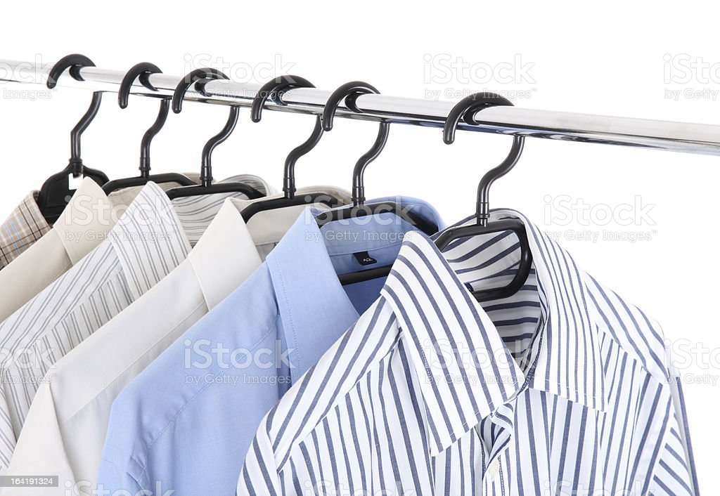 mens shirts hanging on a hanger stock photo