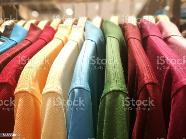 Mens shirts in different colors on hangers in a retail clothes store picture id845223840?b=1&k=6&m=845223840&s=612x612&h=c6zym eoa9dsckdsb01cf q2bdkoe4qtatletfbkb4y=